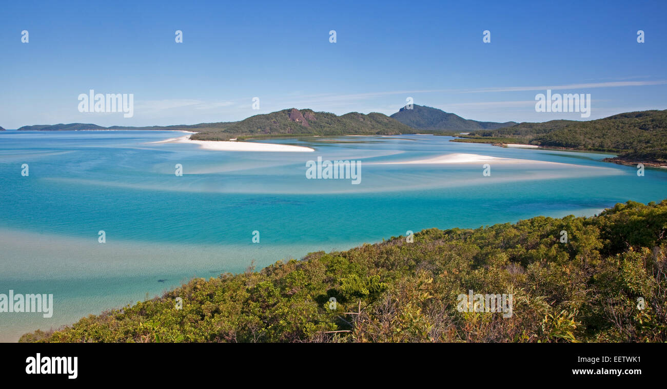 Beaches and turquoise blue water in the bay of Whitehaven Beach on Whitsunday Island in the Coral Sea, Queensland, - Stock Image