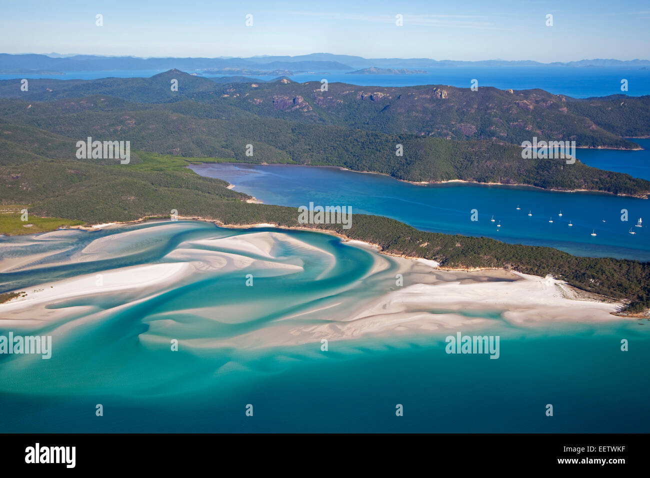 White sandy beaches and turquoise blue water of Whitehaven Beach on Whitsunday Island in the Coral Sea, Queensland, - Stock Image