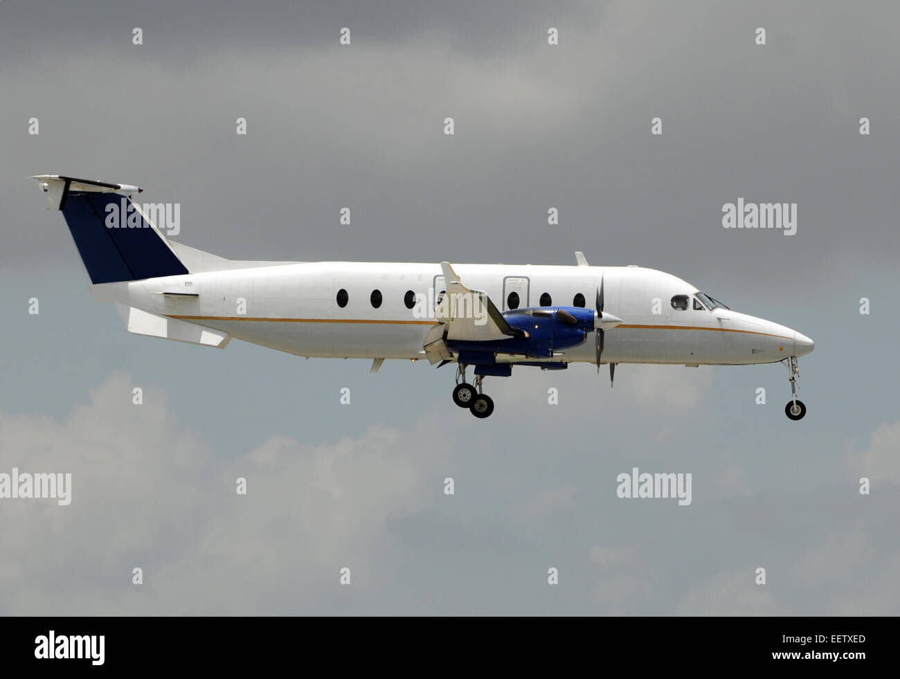Turboprop airplane for regional flight side view - Stock Image