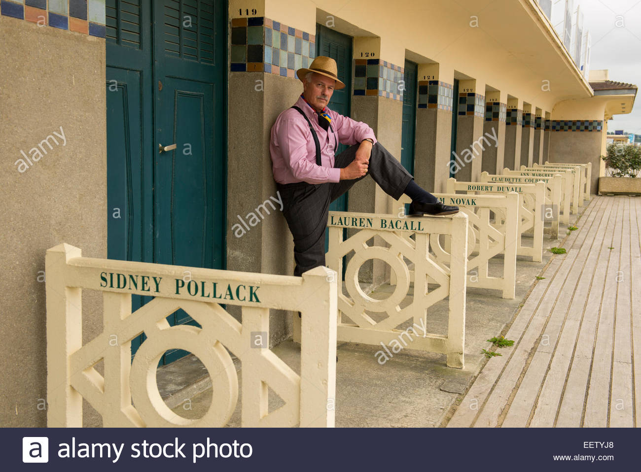 Dapper mature male in front of the summer changing rooms of Deauville - Stock Image