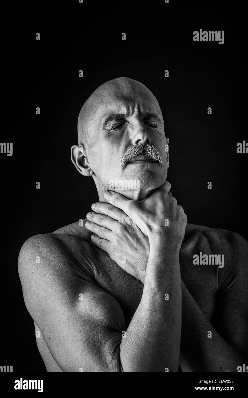 Old man choking BW - Stock Image