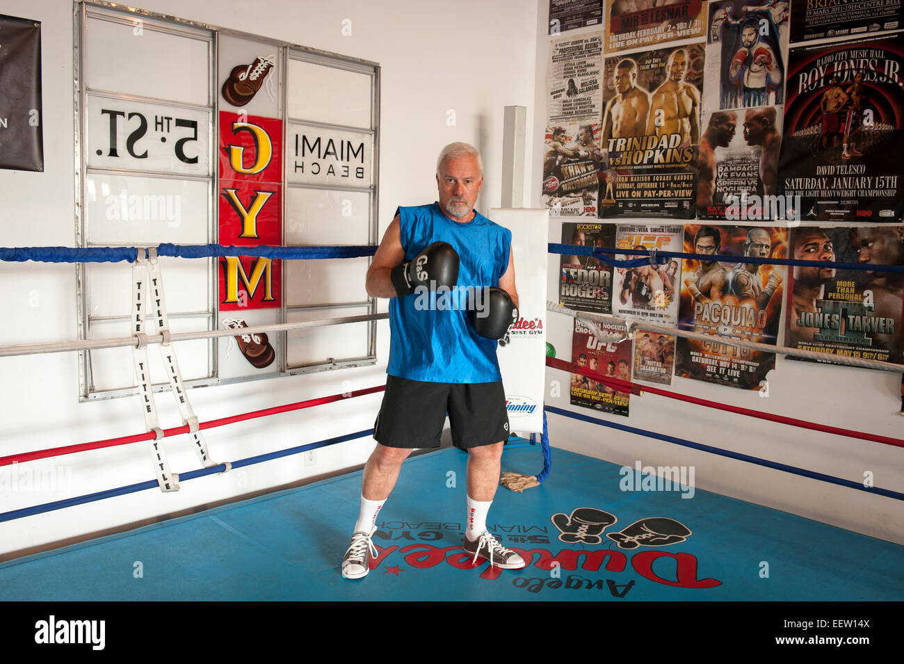 Mature male in a boxing ring preparing to fight - Stock Image