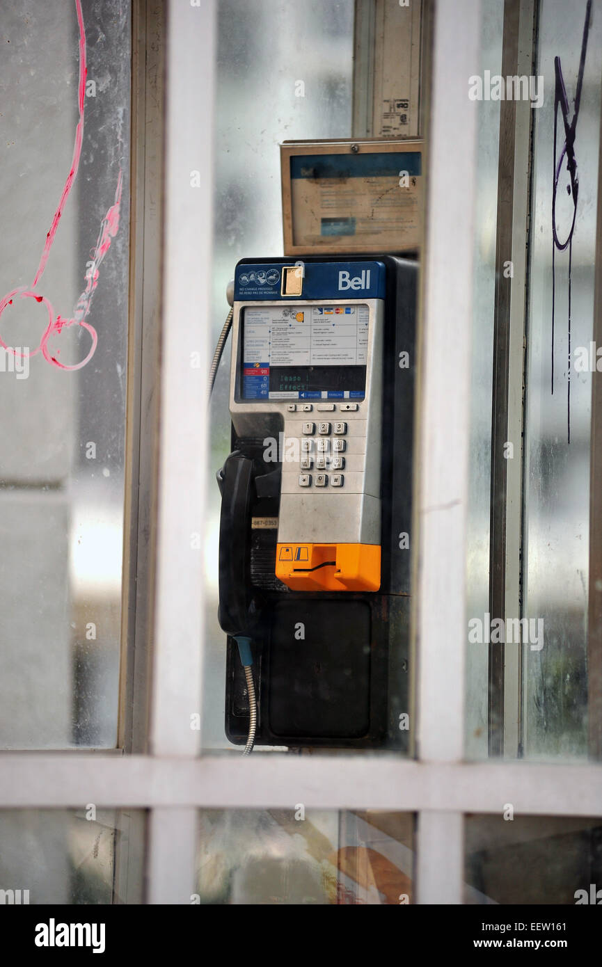 A vandalised Bell public telephone box in London, Ontario, Canada. - Stock Image