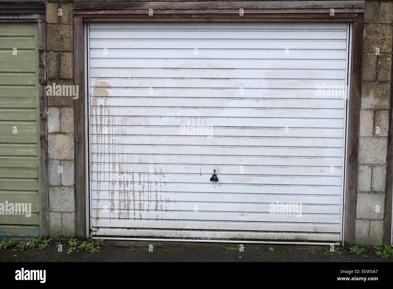 Old worn garage door suitable for a background or texture