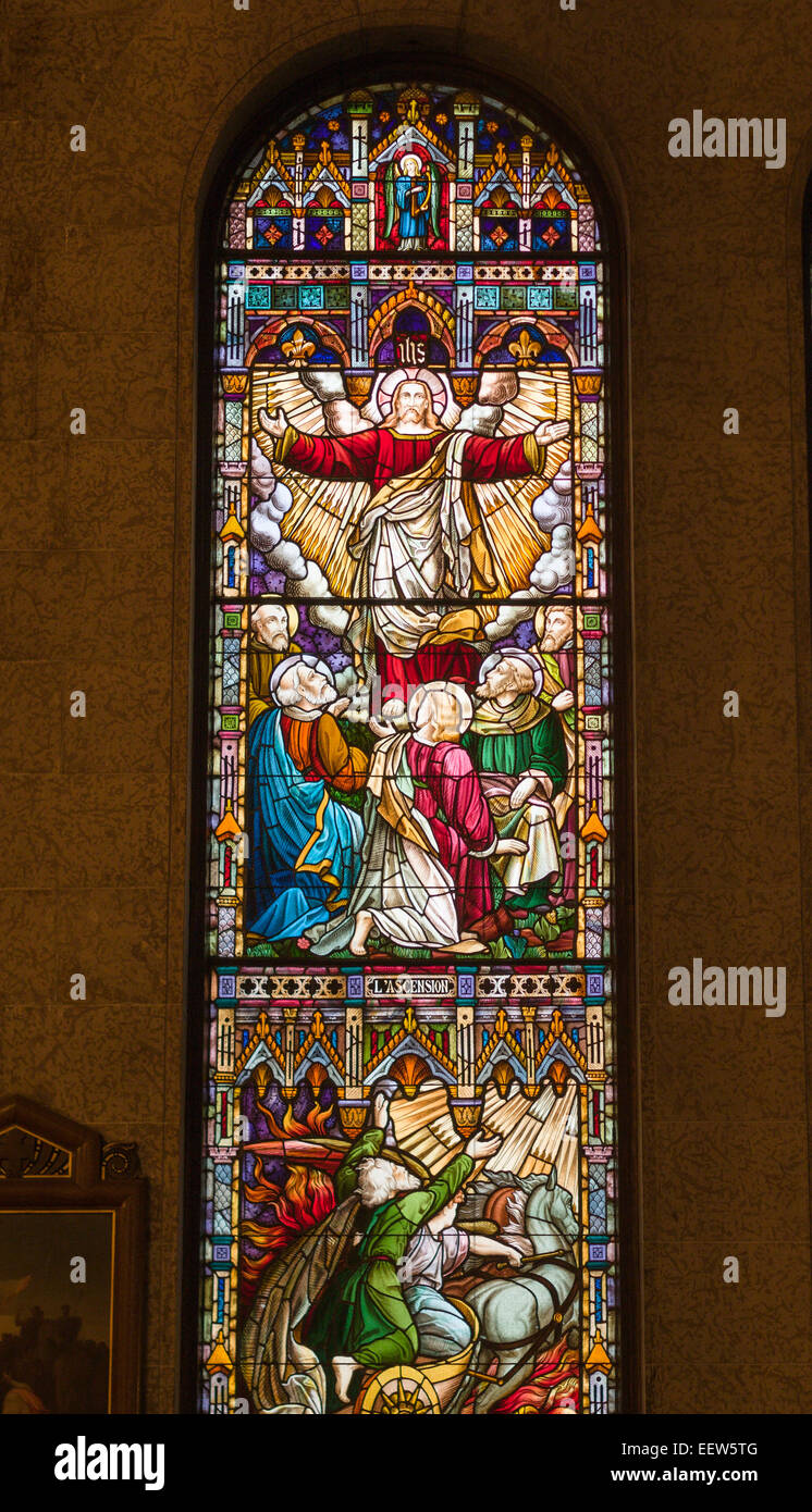 He is Risen: Stained Glass window from St. Roch Quebec. A detailed story telling stained glass window from this - Stock Image