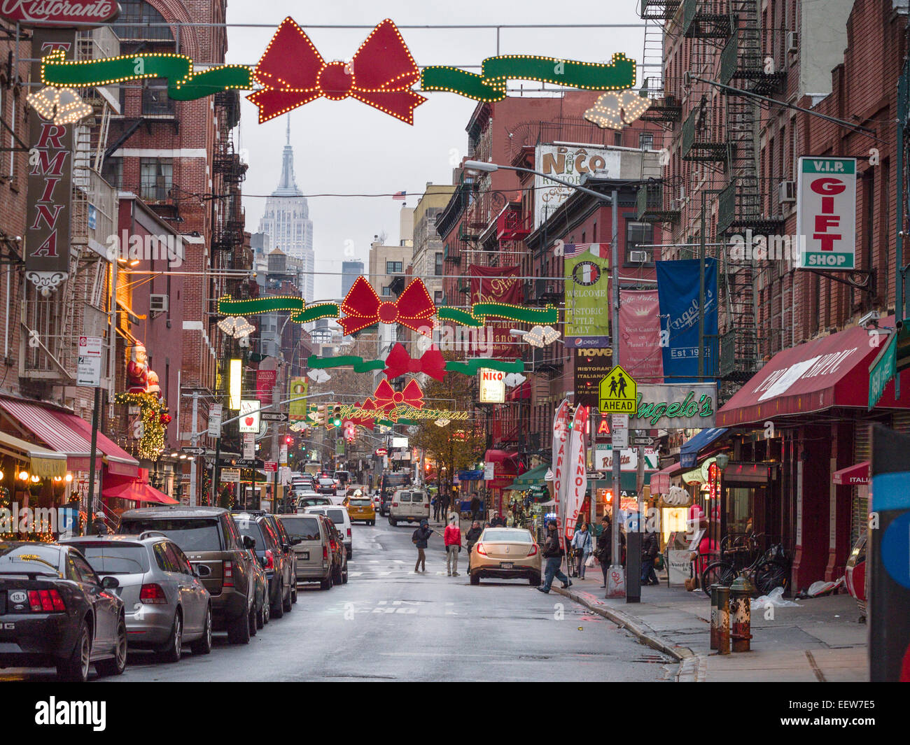 Little Italy all dressed for Christmas. Red bows. lights & a Merry Christmas sign liven up New York's little - Stock Image