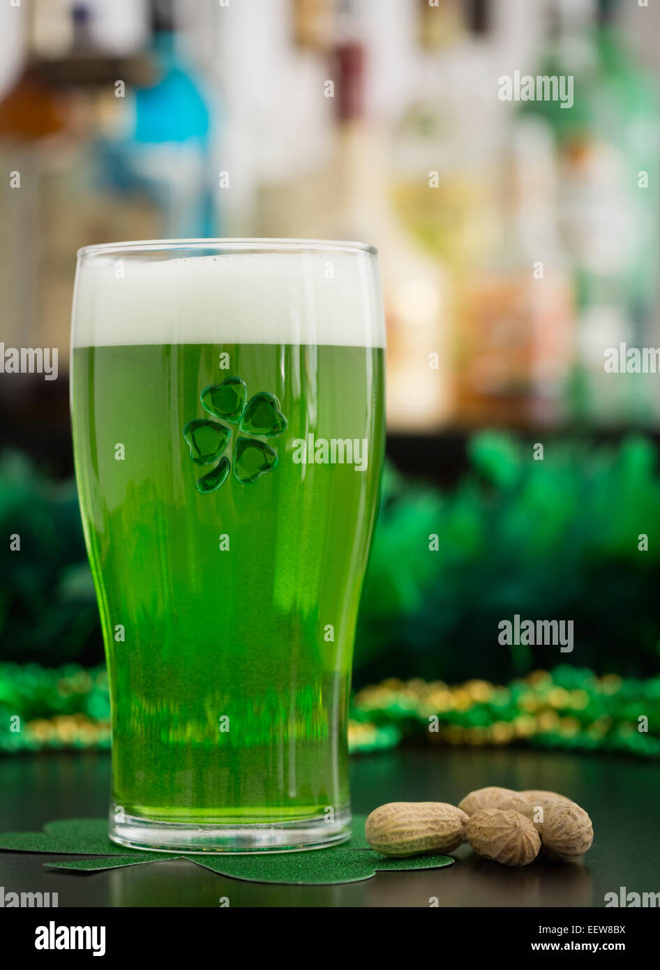 Glass of green beer - Stock Image