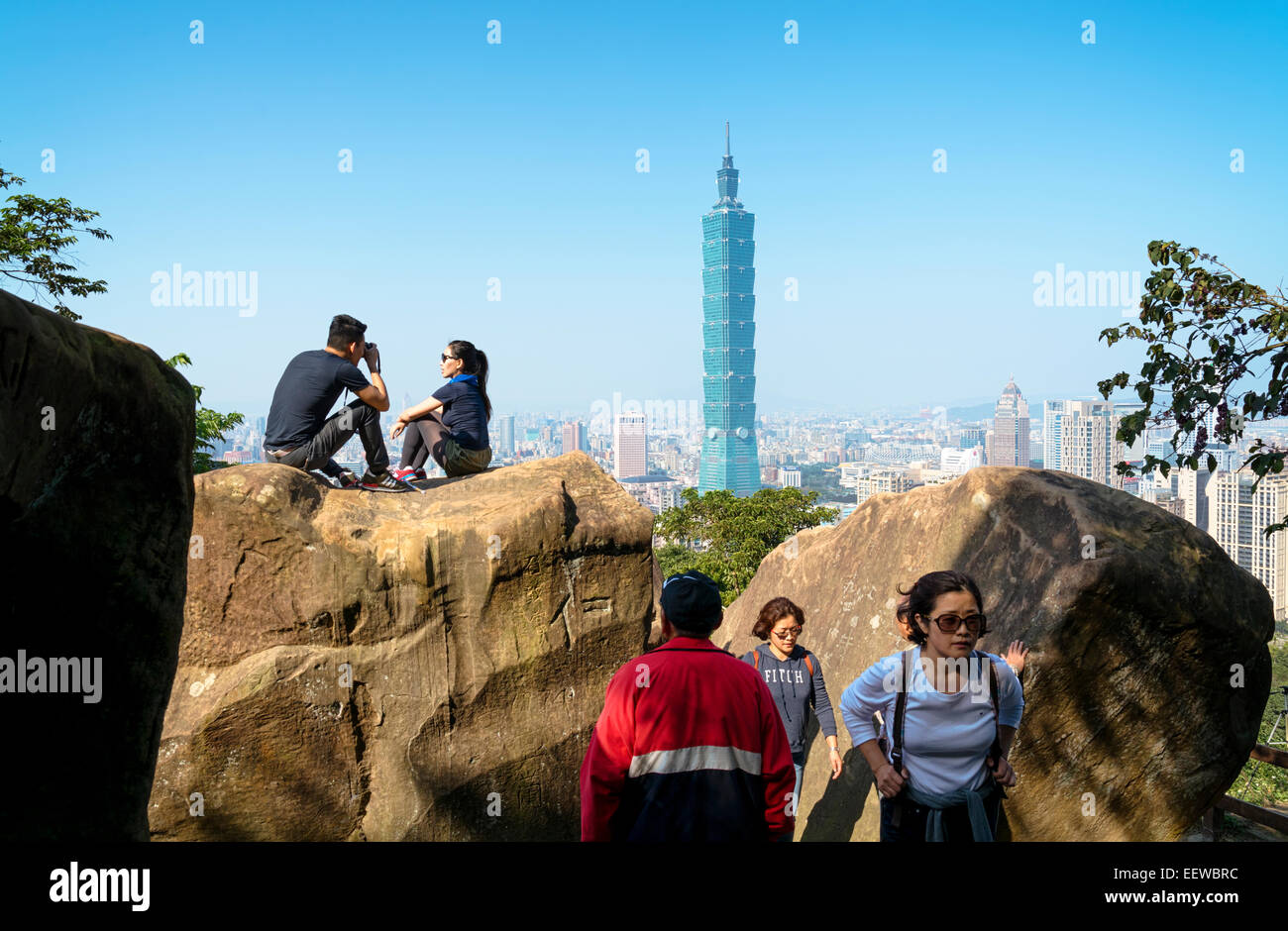 Taipei, Taiwan - Dec 30, 2014: Tourists at the Elephant Mt. in Taipei. Tourists are hiking at the  Nangang District - Stock Image