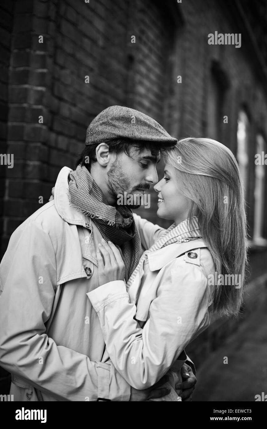 Portrait of romantic dates in stylish casualwear outdoors - Stock Image