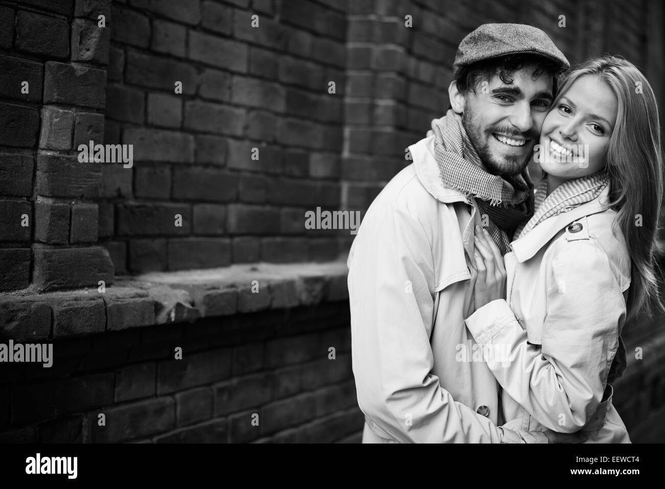 Portrait of romantic dates in stylish casualwear looking at camera - Stock Image