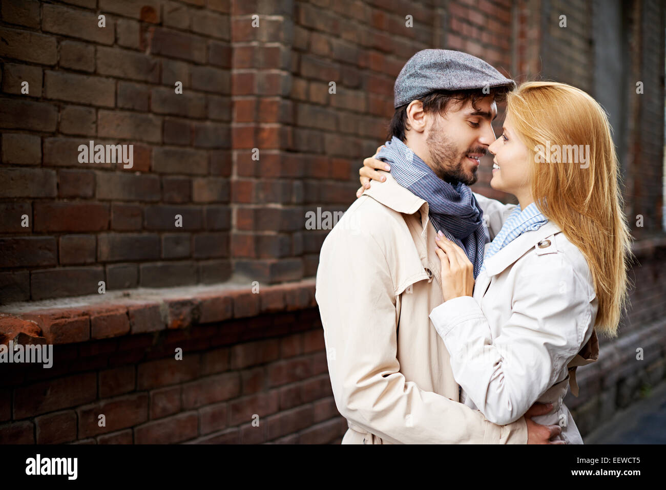 Amorous dates in stylish casualwear in urban environment - Stock Image