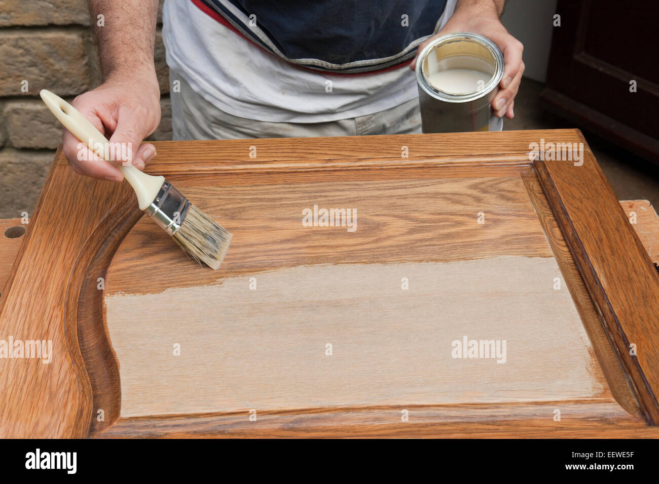 DIY enthusiast paint varnish onto sanded cupboard door - Stock Image & Door Varnish Stock Photos u0026 Door Varnish Stock Images - Alamy