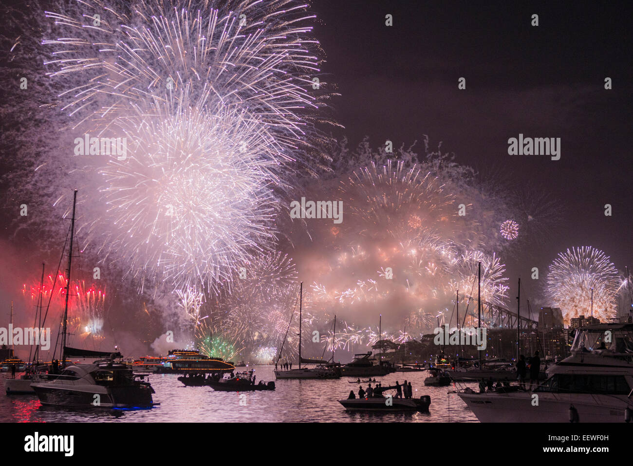 The start of a new year, 2015, with midnight fireworks over the Sydney Opera House, Harbour Bridge and boats in Stock Photo