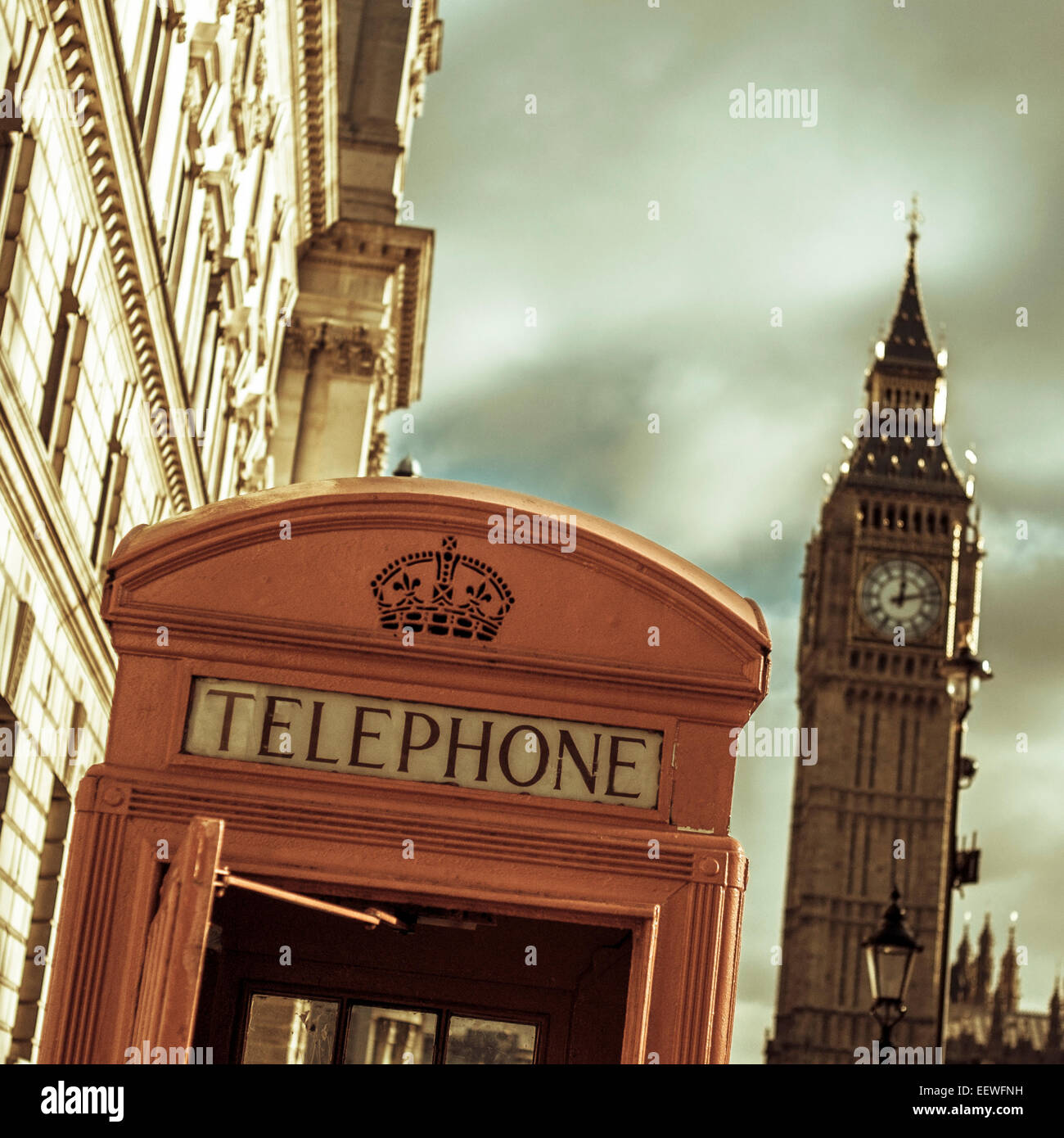 a view of a classic red telephone booth and the Big Ben in the background, in London, United Kingdom, with a filter - Stock Image