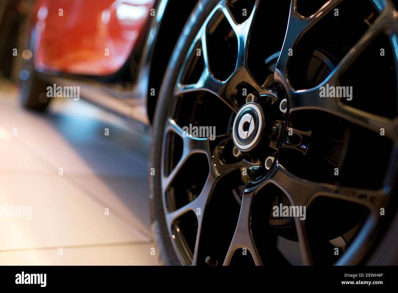 alloy car wheel on mercedes smart car - Stock Image
