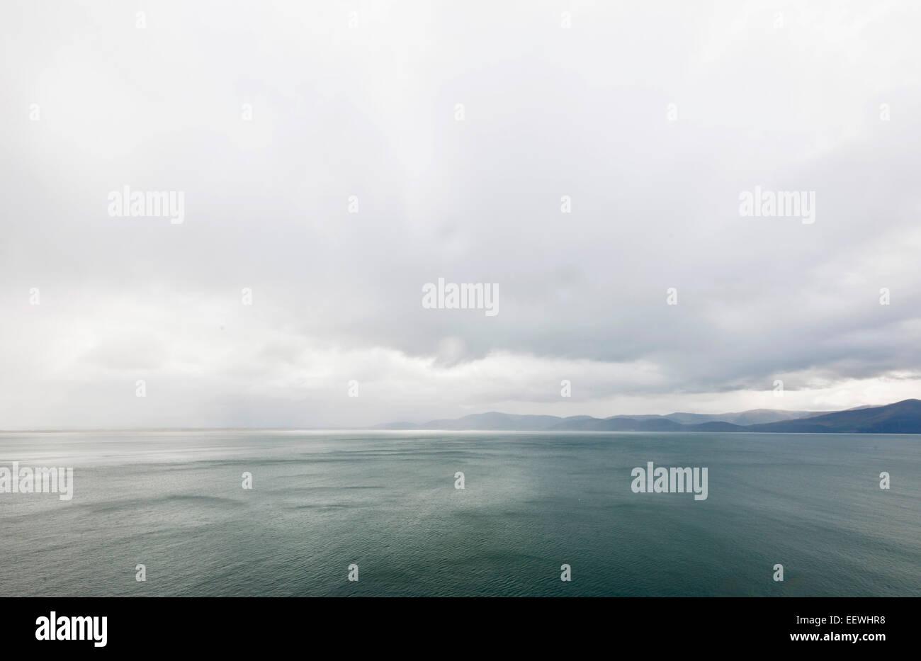 Atlantic Ocean off the misty Irish coast, County Kerry, Ireland - Stock Image