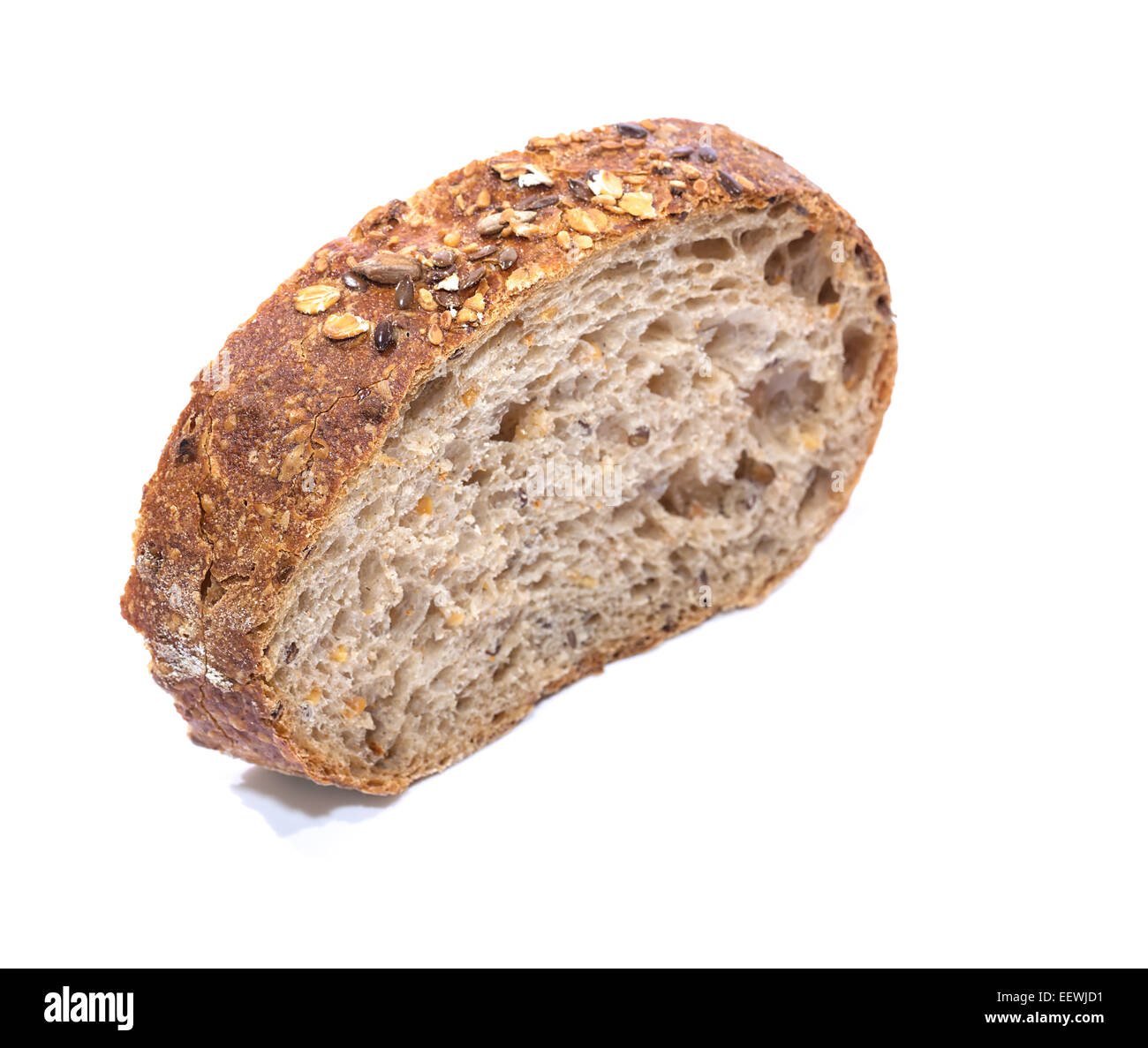 Whole grain bread Slice over white background, diagonal view with shallow focus - Stock Image