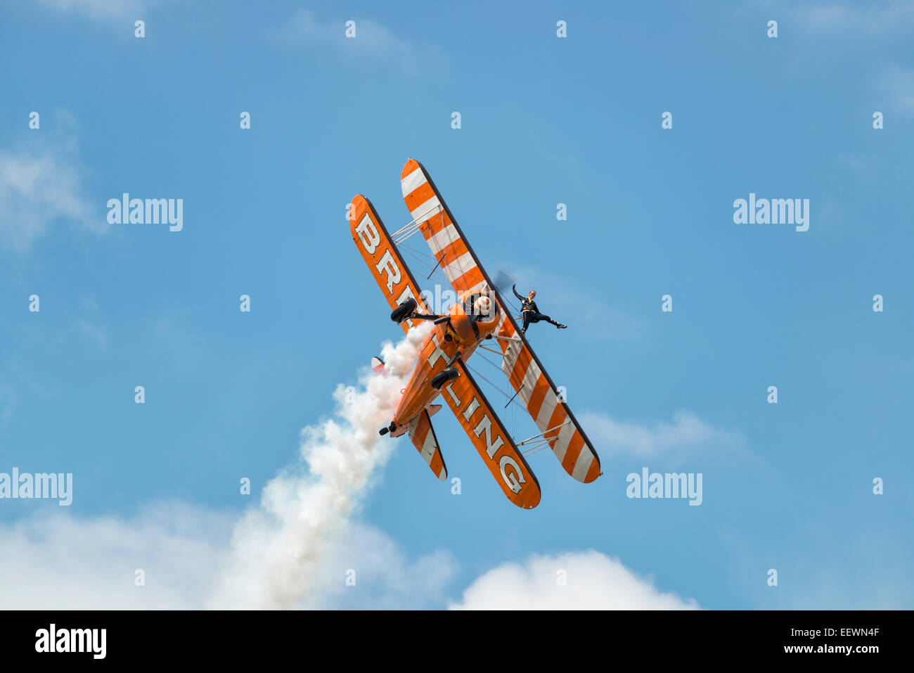 Boeing Stearman Biplane from the AeroSuperBatics Breitling Wingwalking Team makes a pass at the RAF Fairford RIAT - Stock Image