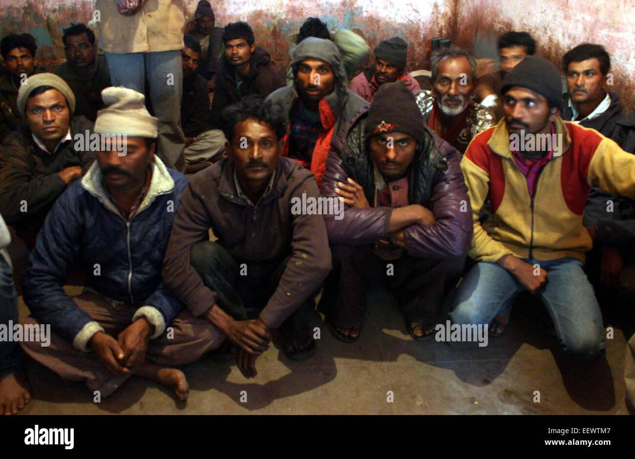 Karachi. 22nd Jan, 2015. Arrested Indian fishermen sit at a police station in southern Pakistani port city of Karachi, - Stock Image