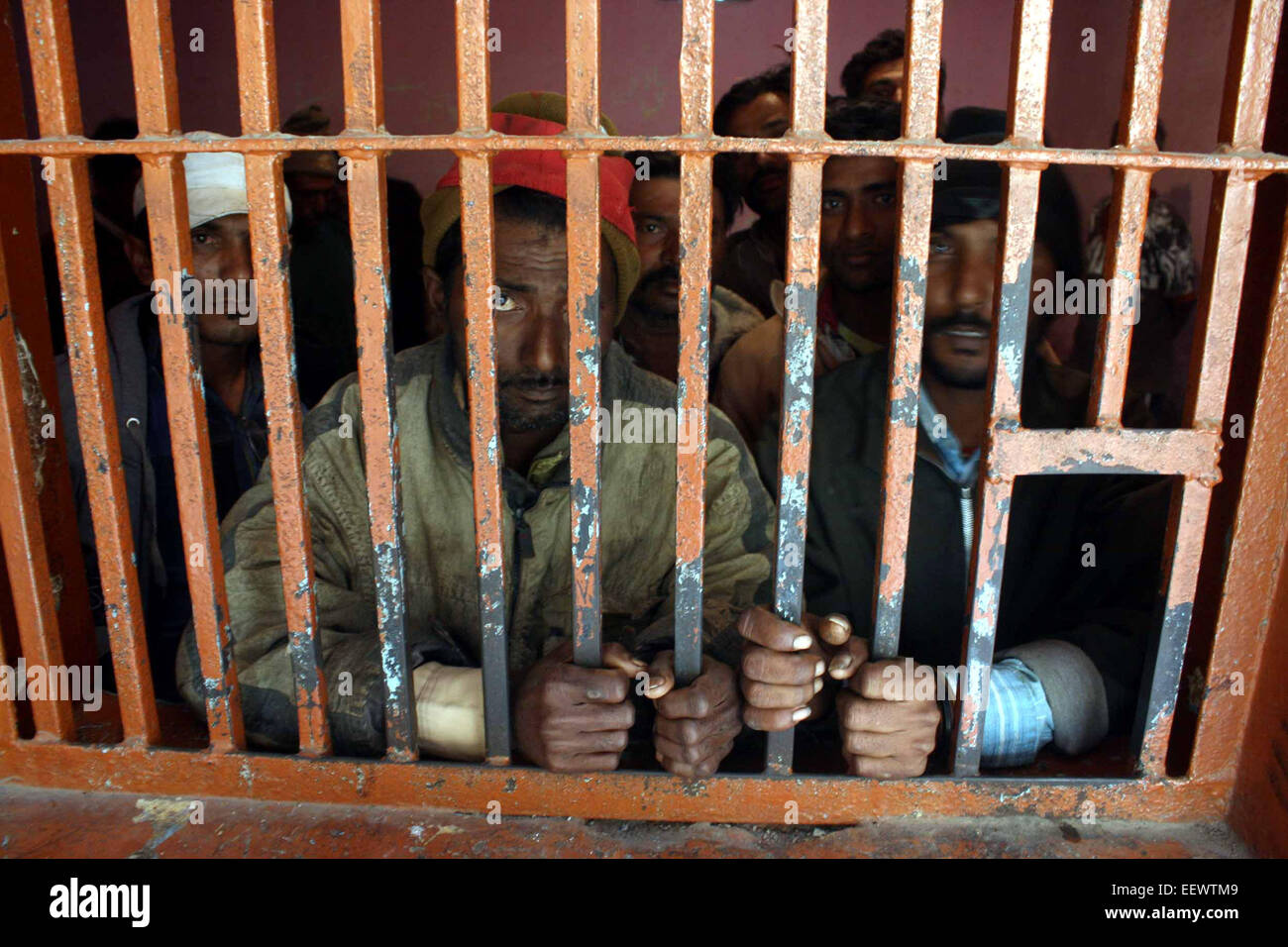 Karachi. 22nd Jan, 2015. Arrested Indian fishermen stand in a police lockup in southern Pakistani port city of Karachi, - Stock Image