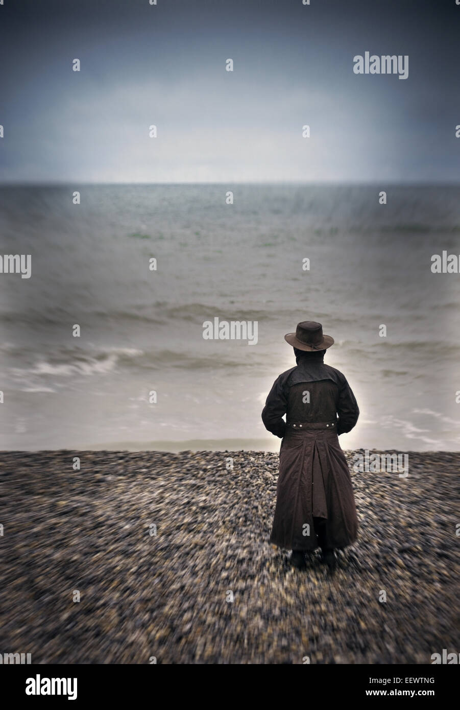 woman looking out to sea - Stock Image