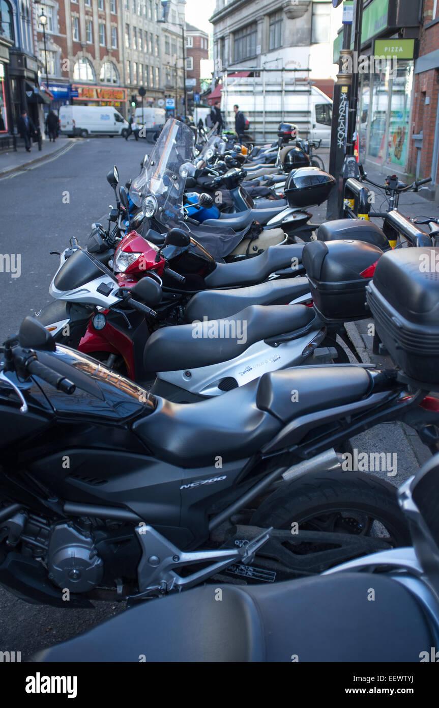 A row of motorbikes parked in Wardour Street, Soho, London - Stock Image