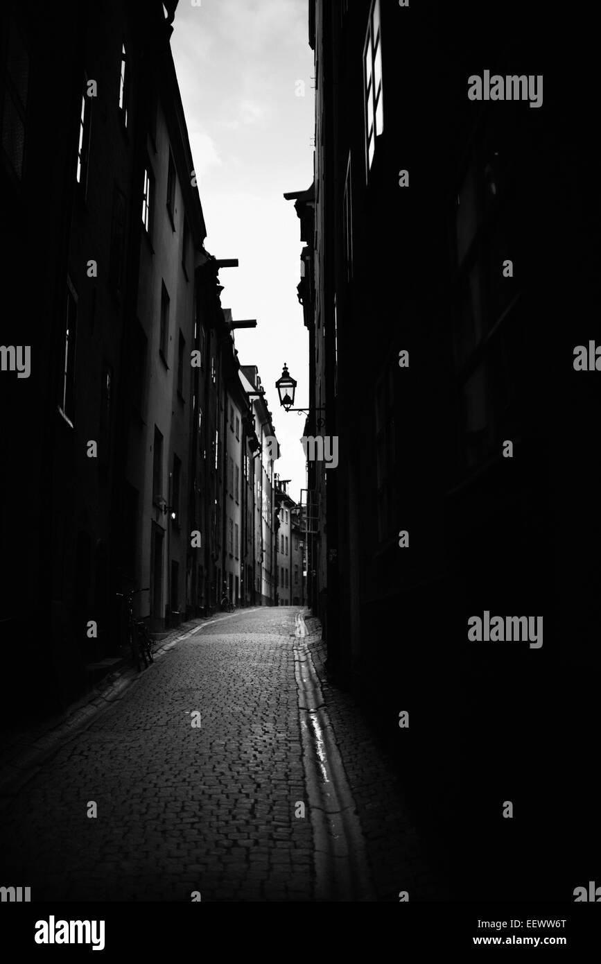 Dark street and buildings in Old Town Stockholm, Sweden. - Stock Image