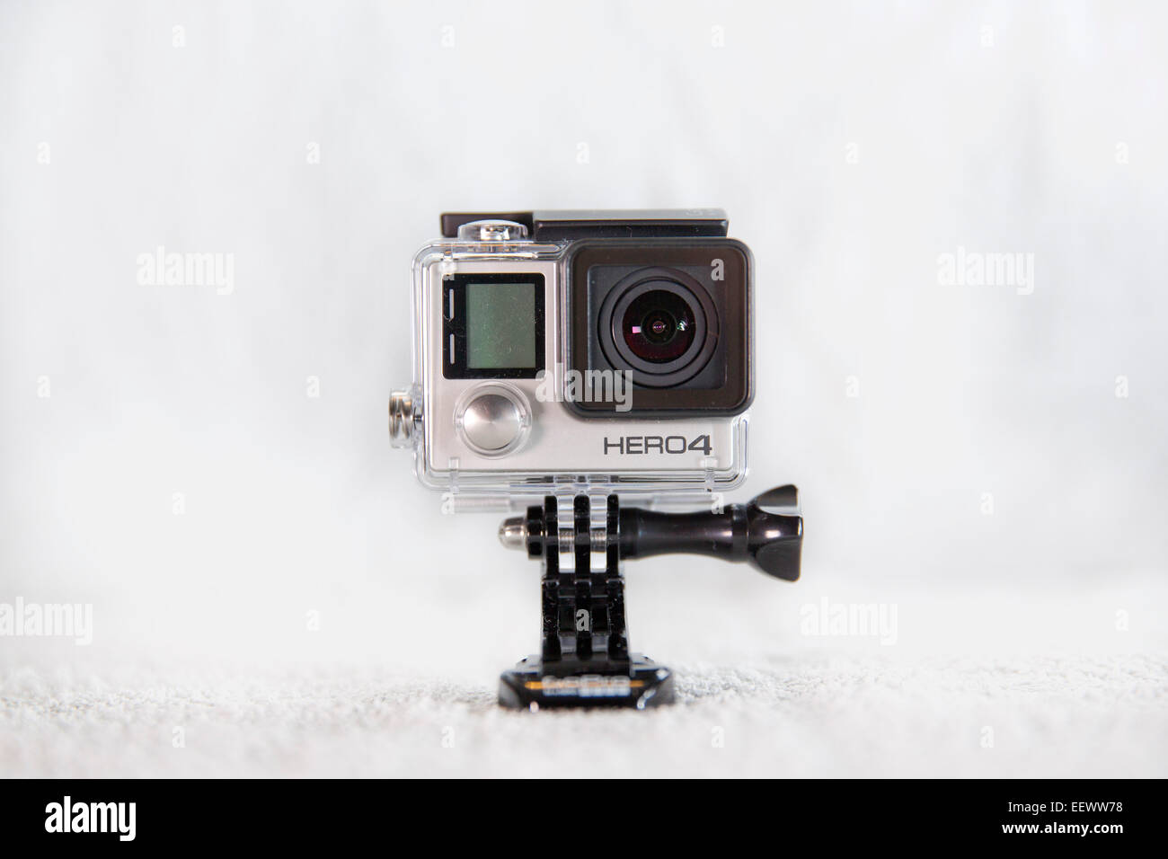 A GoPro Hero 4 Black edition is pictured in its waterproof housing in studio on a white background. - Stock Image