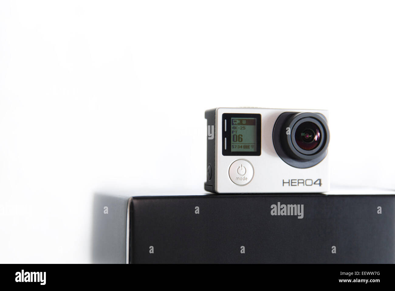 A GoPro Hero 4 Black edition is pictured in a studio on a white background. - Stock Image
