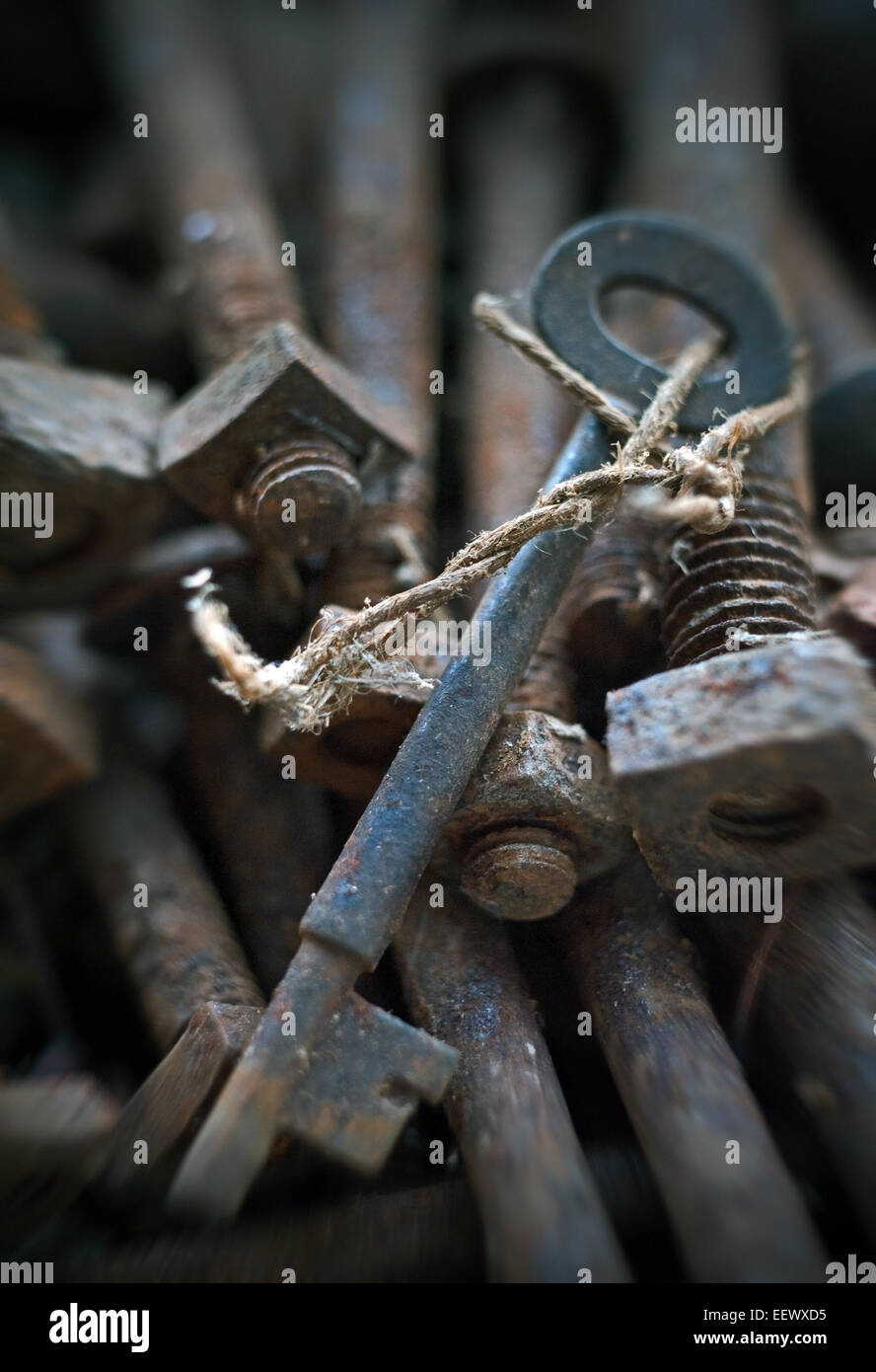 old key hidden in rusty bolts - Stock Image