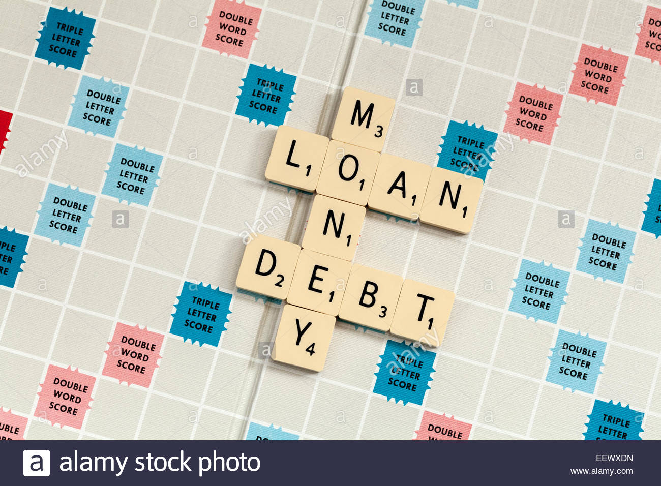 The words Loan Money and Debt spelled out on a scrabble board - Stock Image