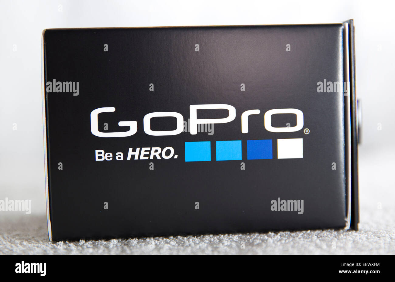 A GoPro Hero 4 Black edition box is pictured in a studio on a white background. - Stock Image