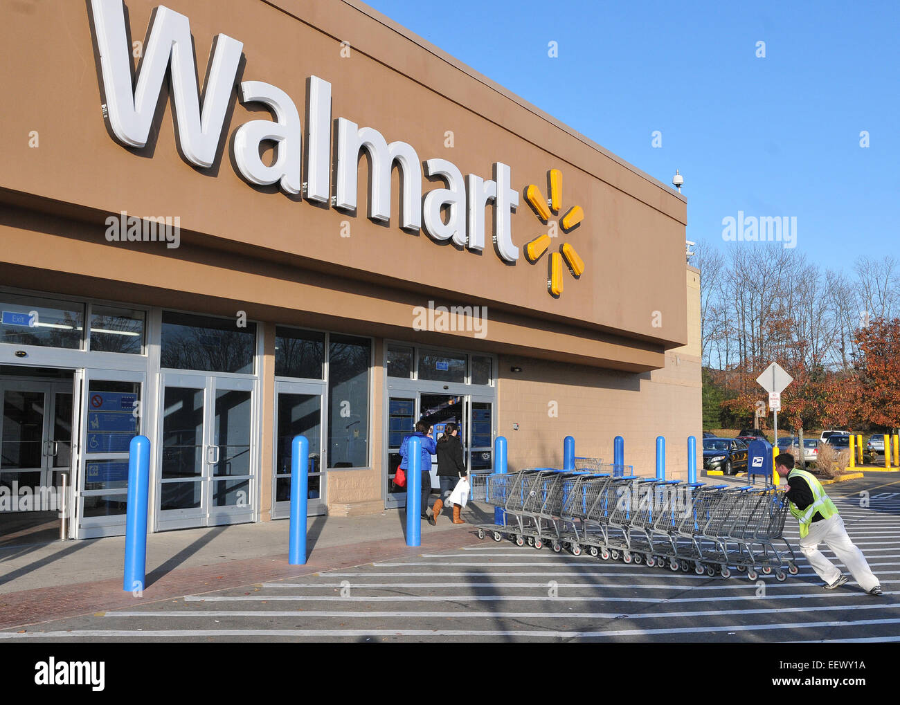 branford ct usa a worker collects carts at the branford walmart walmart opens tomorrow