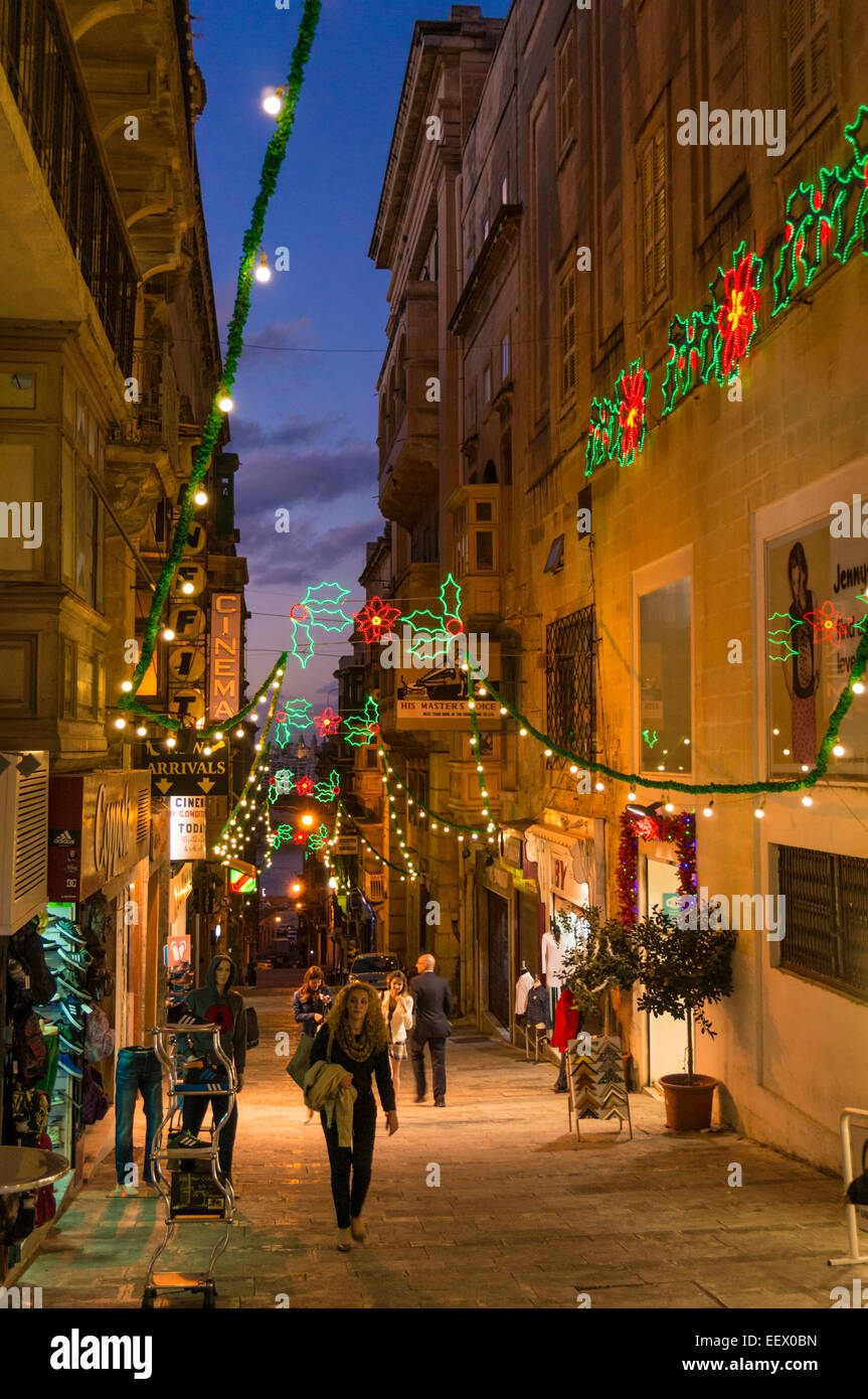 Christmas decorations and shoppers in old town Valletta Malta EU Europe - Stock Image