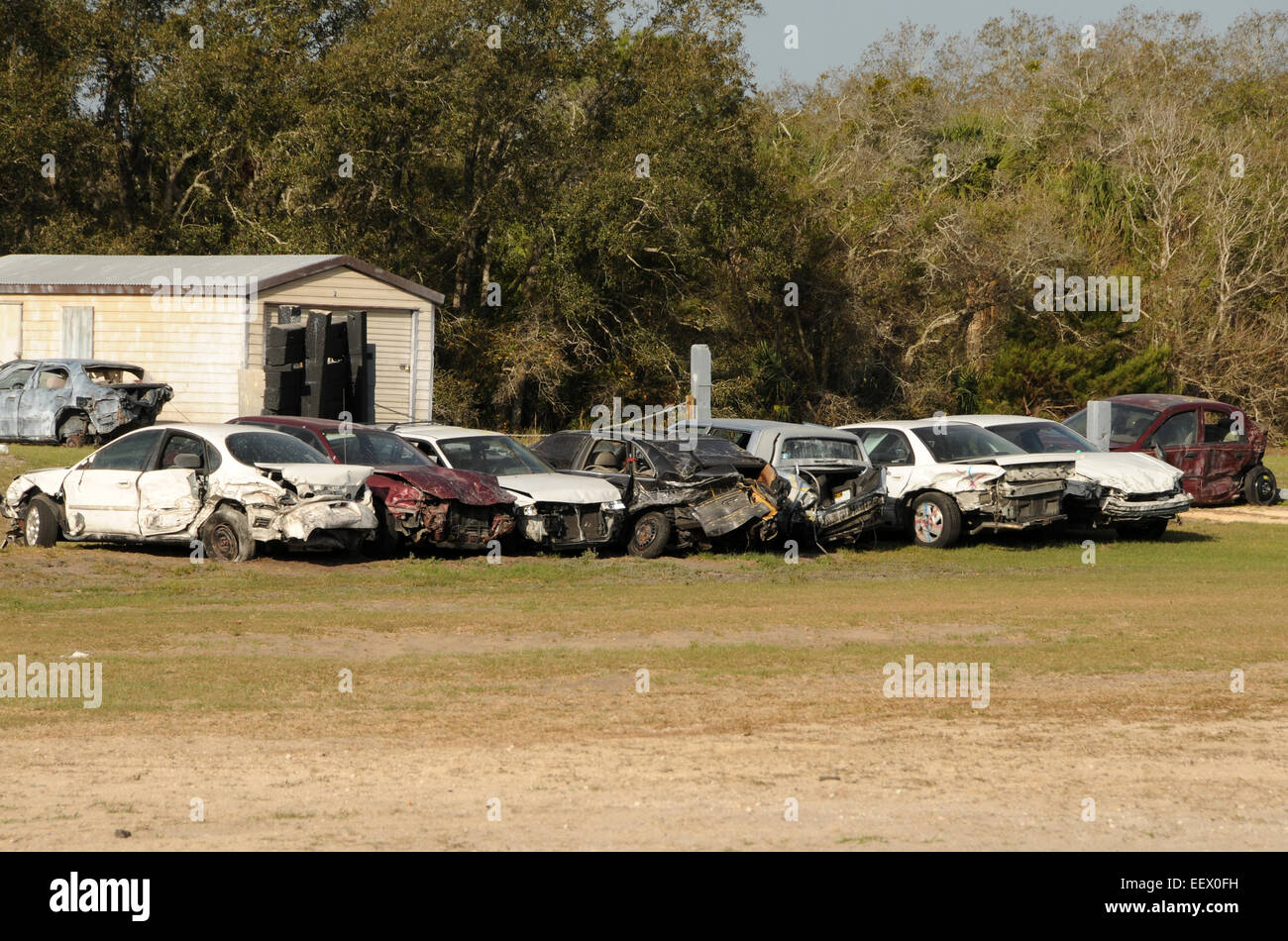 Old abandoned cars in junk yard - Stock Image