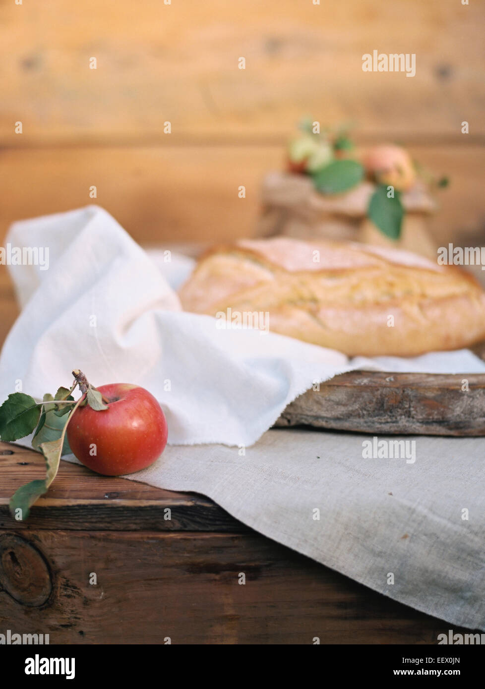 Apple orchard. A table with food. - Stock Image