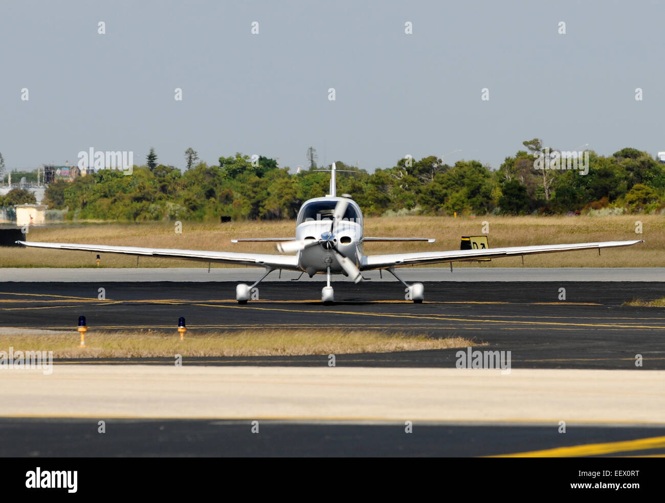 Light private airplane taxiing on the ground - Stock Image