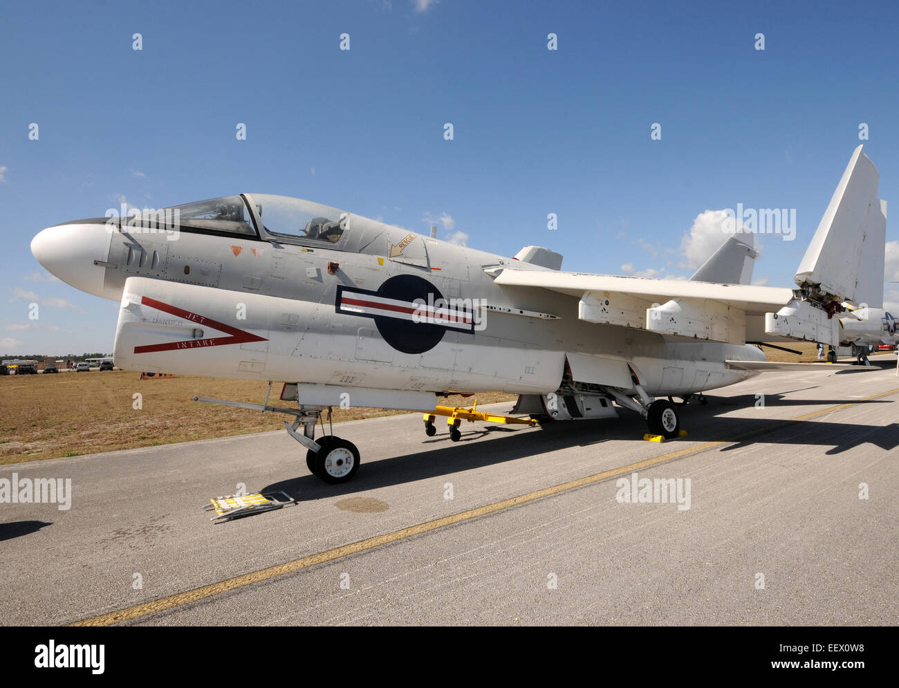 US Navy jet fighter parked on a remote airfield A-7 Stock Photo
