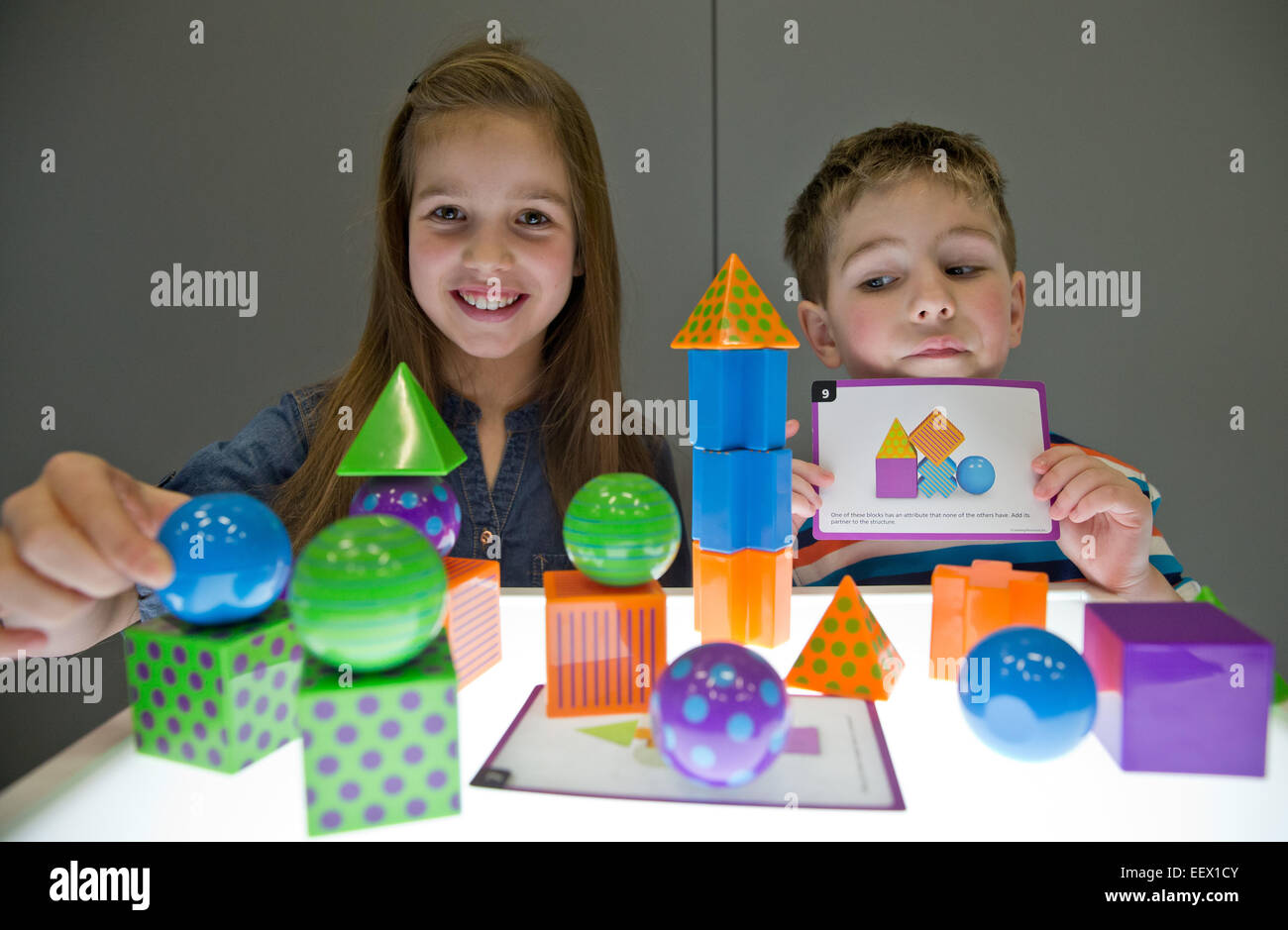 Nuremberg, Germany. 22nd Jan, 2015. Nina and Marcus play with Mental Blox Critical Thinking Challenge by Learning - Stock Image