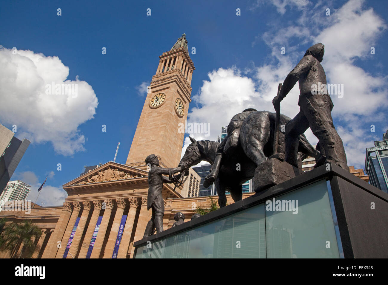 Sculpture group and clock tower of Brisbane City Hall, capital town of Queensland, Australia - Stock Image
