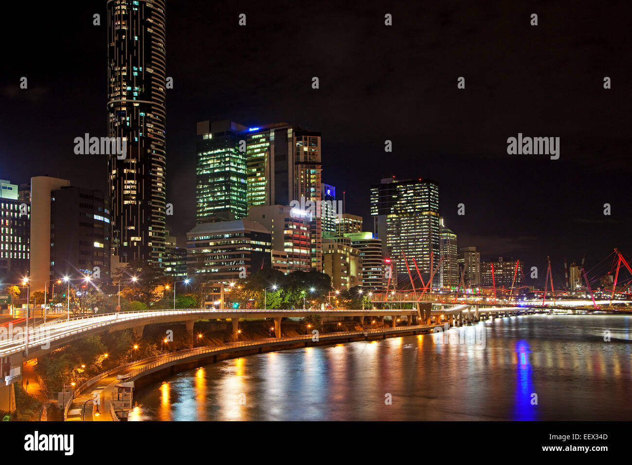 Skyline of Brisbane central business district showing skyscrapers and highrise office blocks by night, Queensland, - Stock Image