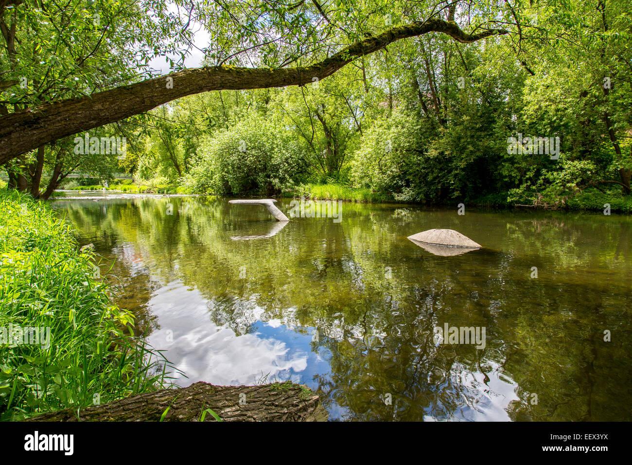 "River Ruhr in Arnsberg, Sauerland region,  Artwork ""Ruhr Whale"" sculpture in the river Stock Photo"
