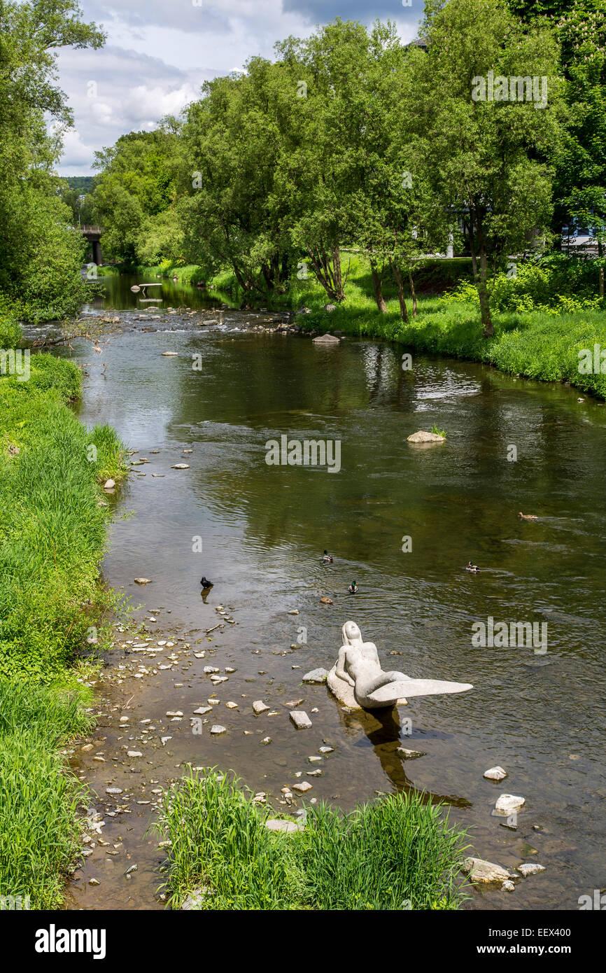 River Ruhr in Arnsberg in Sauerland region, artwork mermaid sculpture in the river Stock Photo