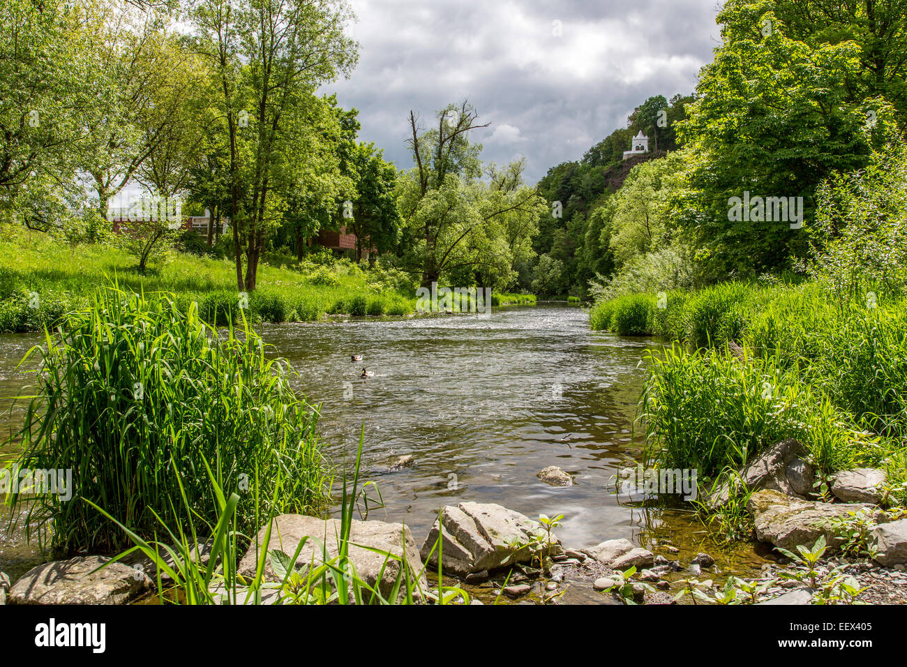 River Ruhr in Arnsberg in Sauerland region, artwork mermaid sculpture in the river Stock Photo