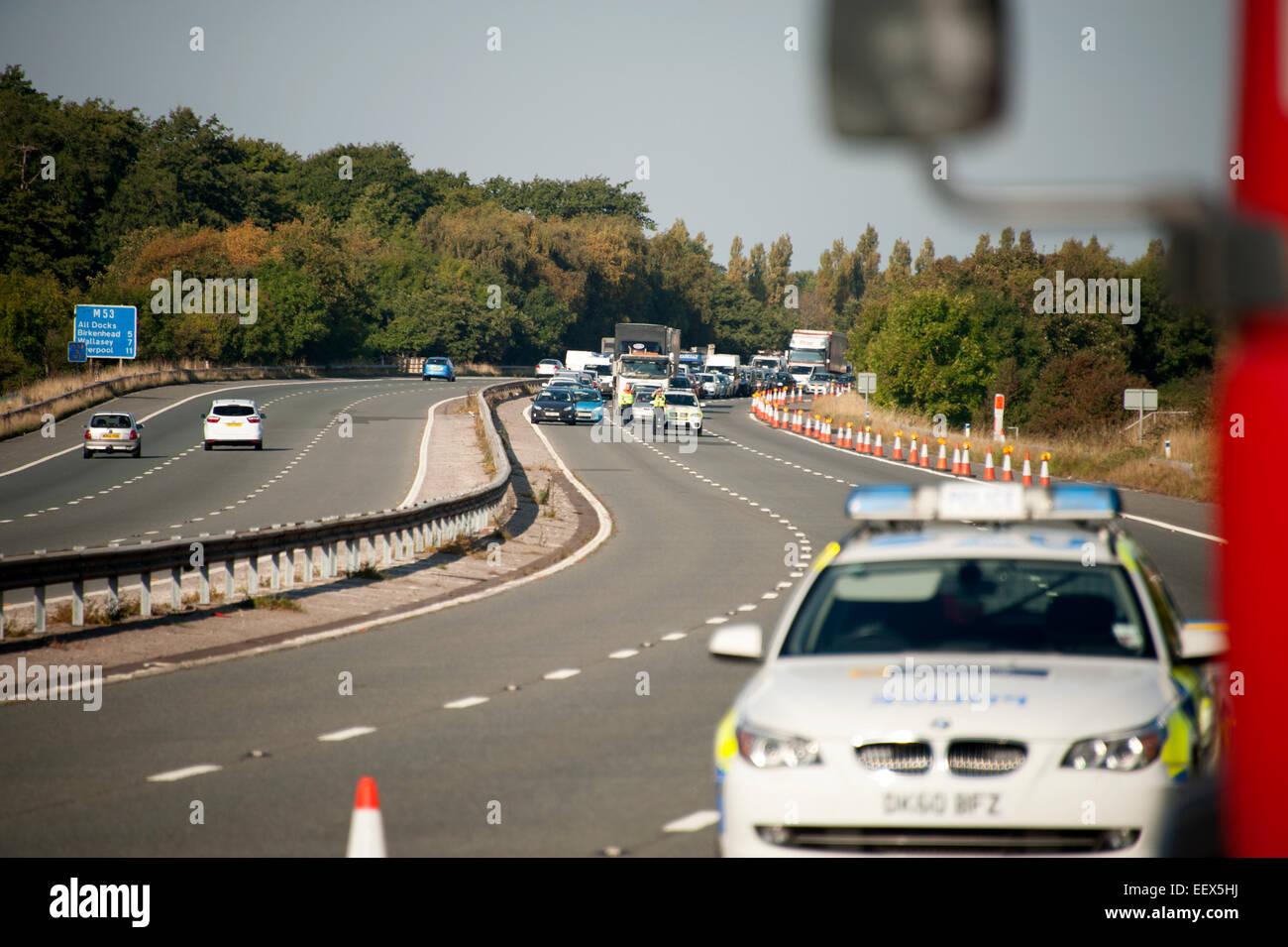 Police Motorway rolling Roadblock Crash RTC Closed - Stock Image