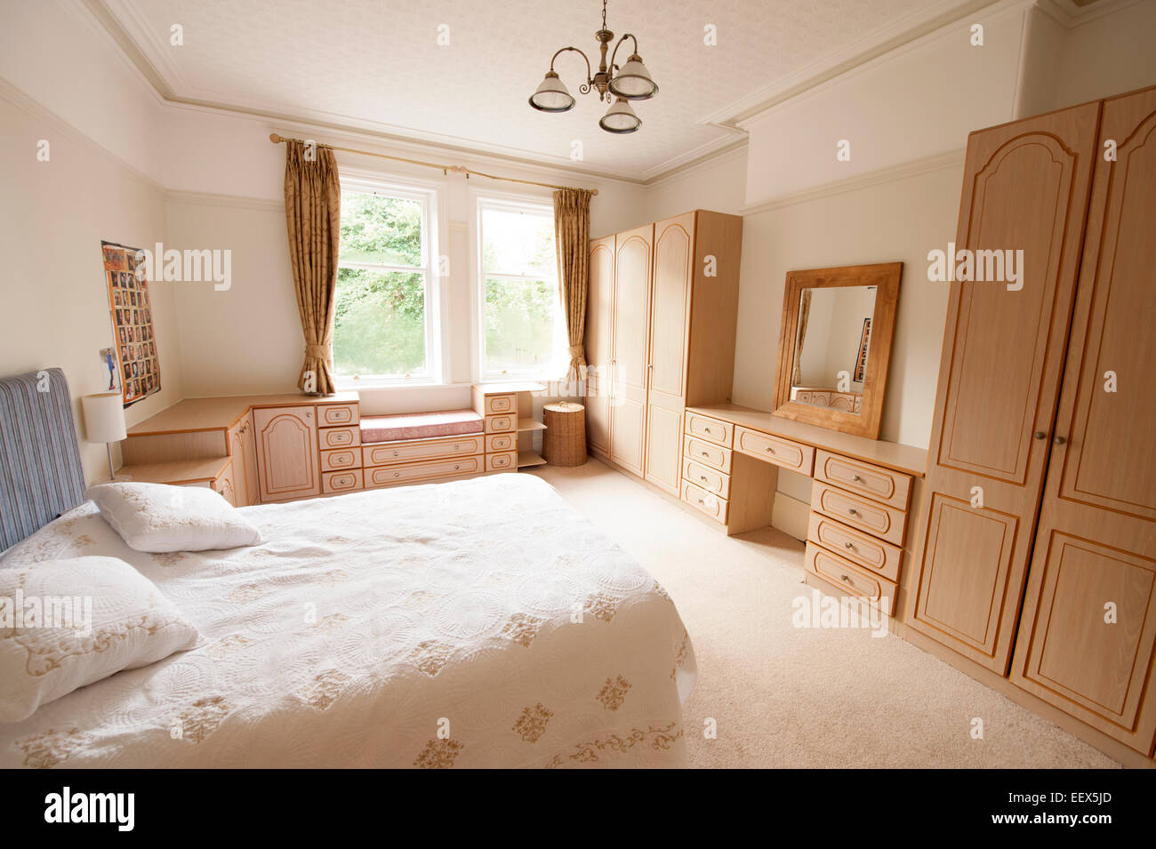 fitted bedrooms glasgow in modern light airy master bedroom fitted wardrobes stock image photos images alamy