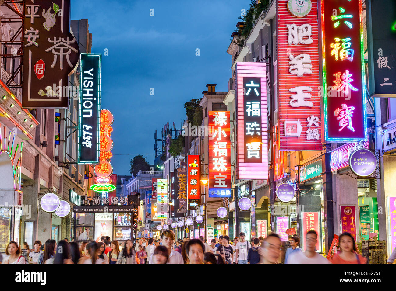 Pedestrians pass through Shangxiajiu Pedestrian Street. The street is the main shopping district of the city. - Stock Image