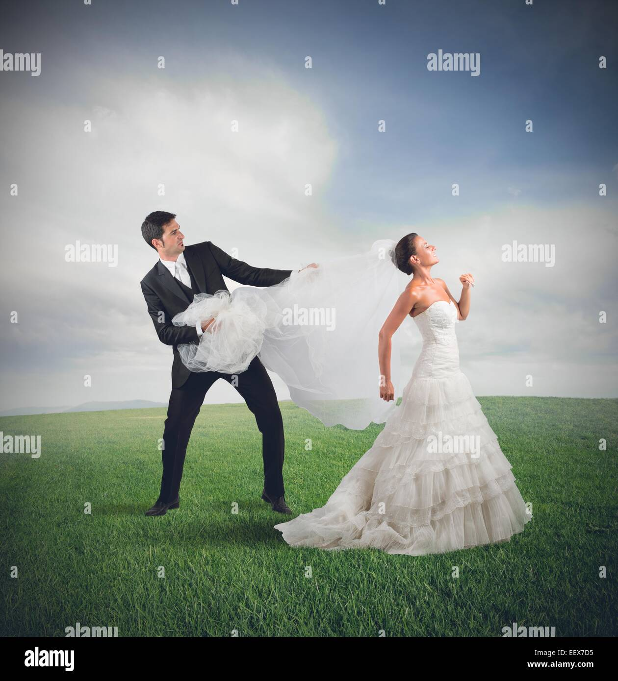 Bride runs away - Stock Image