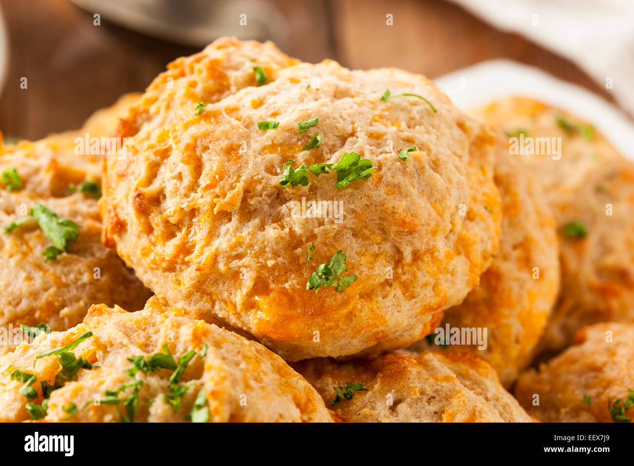 Homemade Cheddar Cheese Biscuits with Parsley - Stock Image