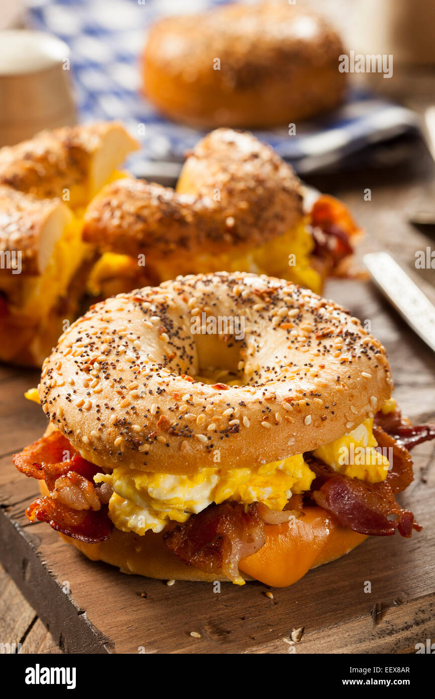 Hearty Breakfast Sandwich on a Bagel with Egg Bacon and Cheese Stock Photo